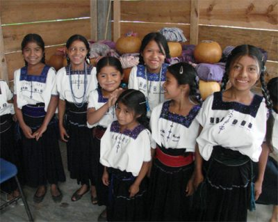 Zapatista students in front of squash containers holding GMO-free corn tortillas in Chiapas, Mexico