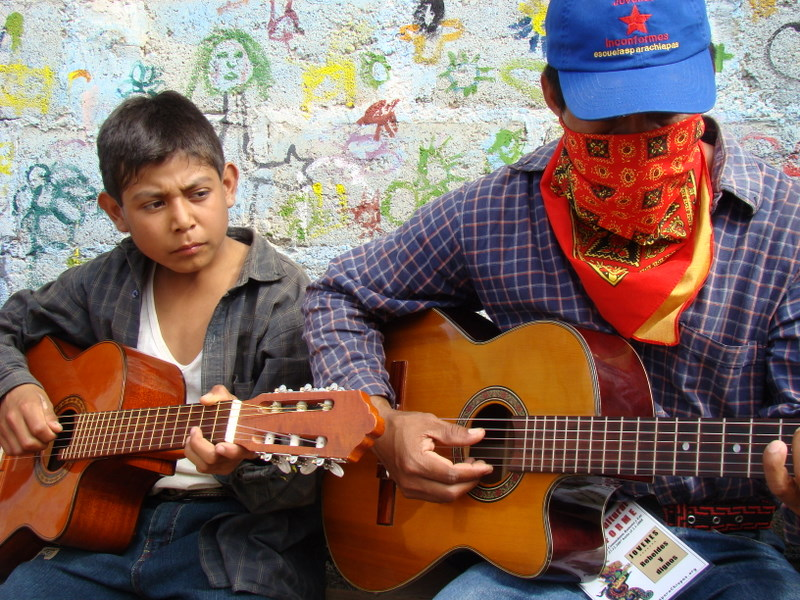 Zapatistas playing guitar