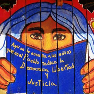 School mural of Zapatista blue haired woman in Chiapas, Mexico.