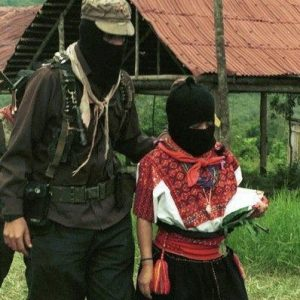 Marcos walks with Ramona to the helicopter which will fly her to Mexico City from the Zapatista community of La Realidad, Chiapas, Mexico.