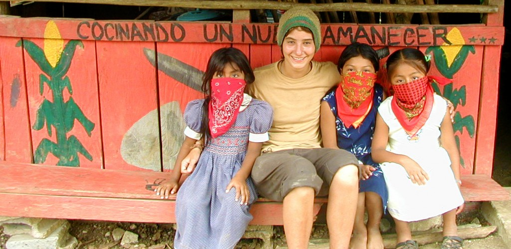 Zapatista girls and visitor
