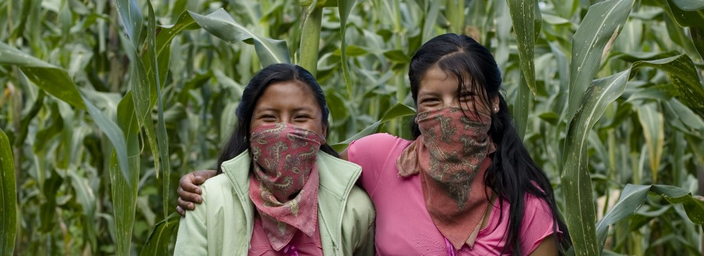 Zapatista women smiling with corn