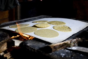 GMO-free corn tortillas cooking in a Mayan home in Zapatista territory in the highlands of Chiapas, Mexico.