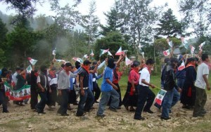 Zapatista students marching and waving Mexican flags at an autonomous Middle school in Chiapas to celebrate September 16, Mexican Independence Day.