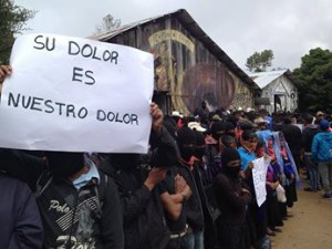 "Zapatistas recieve parents of the 43 disappeared student-teachers in the caracol of Oventic on November 15, 2014. The sign reads, ""Your pain is our pain."""