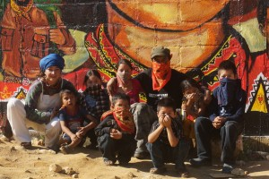 Young Zapatista artists with Mitzi and Gustavo during 2014 mural painting in the northern zone of Roberto Barrios, Chiapas, Mexico.